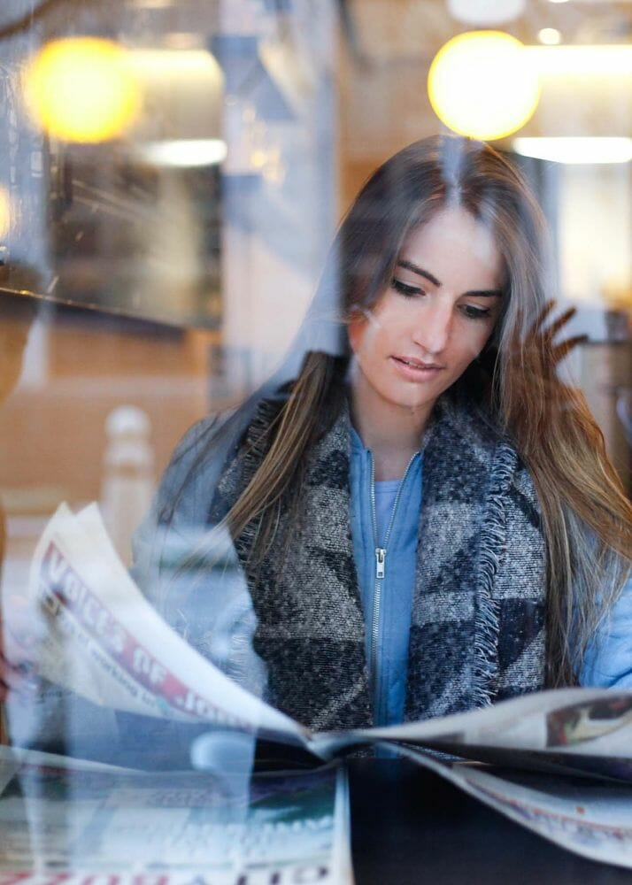 Woman reading the newspaper